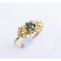 Solitaire teal sapphire ring